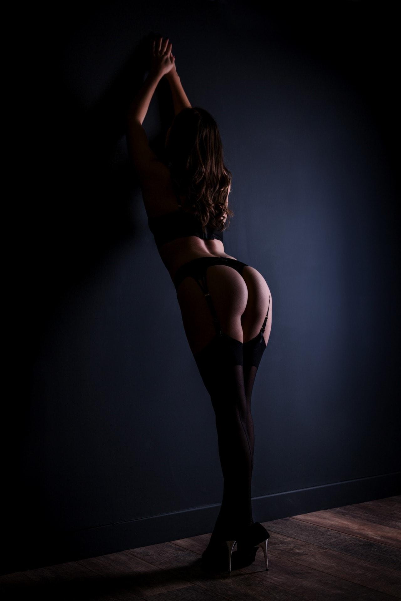 best-boudoir-photography-dark-wall-suspenders