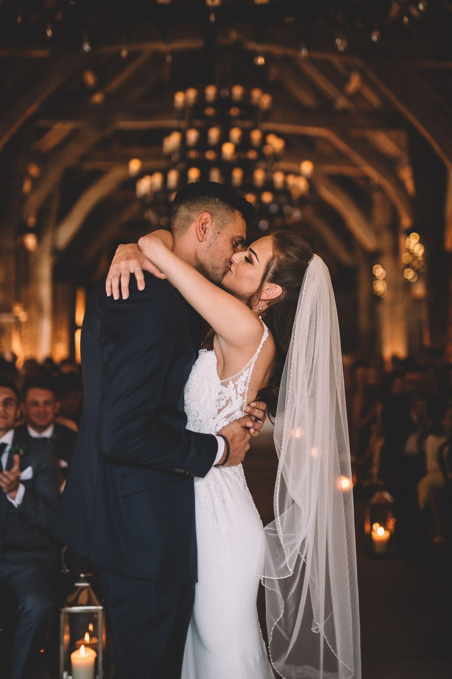 first-kiss-wedding-ceremony-tithe-barn